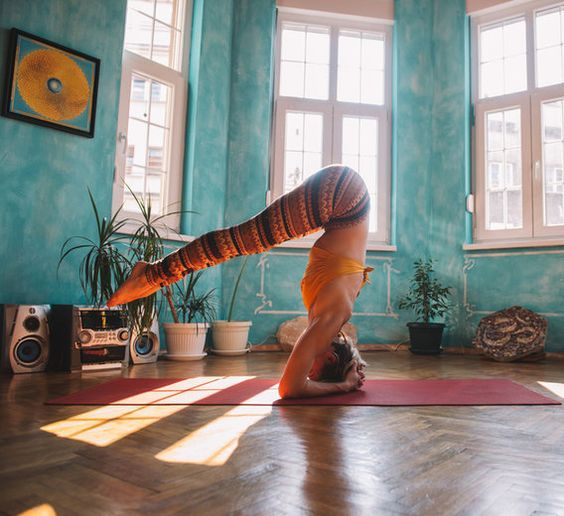 yoga girl doing headstand on her forearms